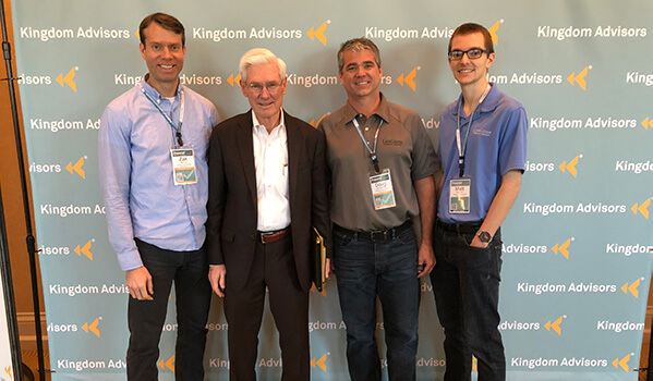 Zak, Doug, and Matt with Kingdom Advisors' founder, Ron Blue.